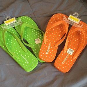 Two pair of Montego Bay flip flops
